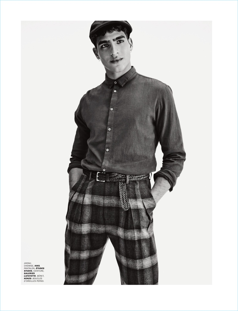 Jhonattan Burjack dons an IKKS shirt with Etudes Studio pants, a Galeries Lafayette belt, and Kenzo beret.