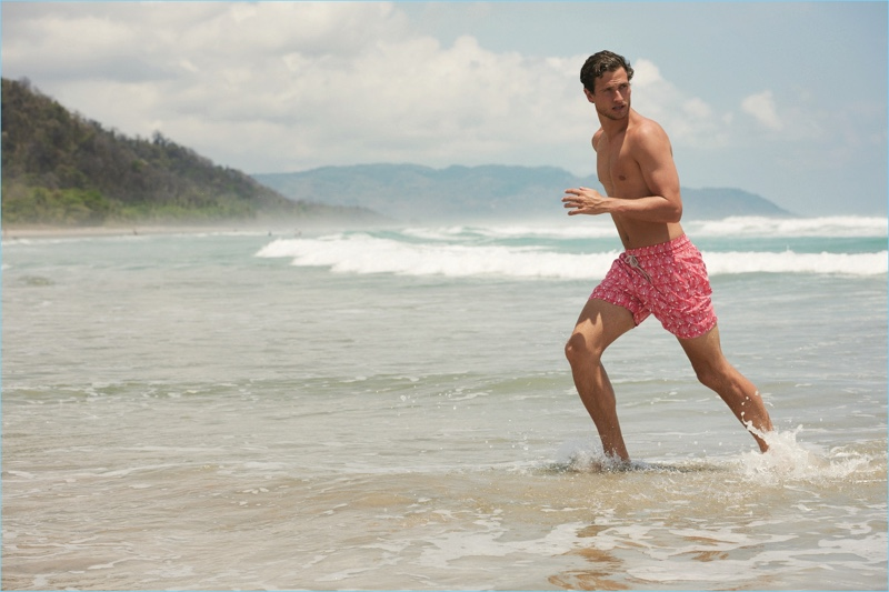 Tom Warren takes to the beach, wearing The Jay & The Peacock swim shorts by Love Brand & Co.
