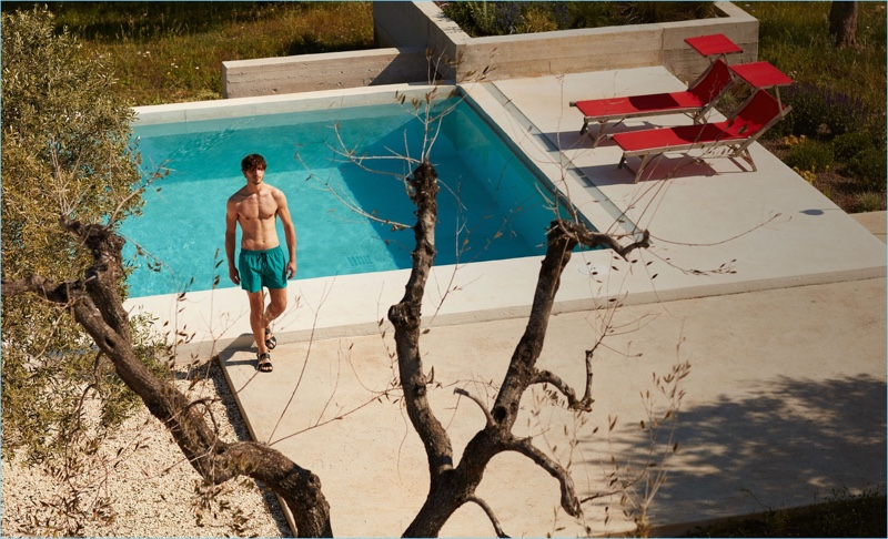 A summer vision, Rodolphe Zanforlini wears Everest Isles swim shorts $181 and Paul Smith leather sandals $192.