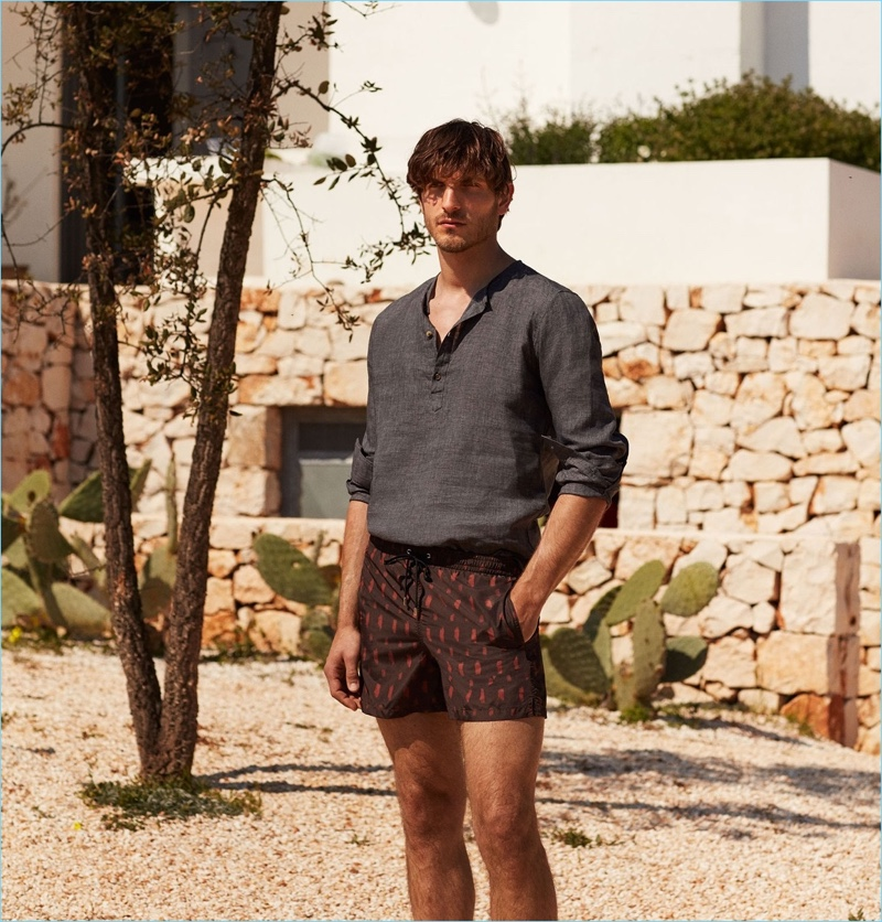 Keeping cool, Rodolphe Zanforlini wears a De Bonne Facture linen shirt $170 and Boglioli smudge-print swim shorts $160.