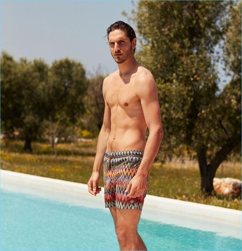 Embracing Italian style, Rodolphe Zanforlini wears Missoni chevron-stripe print swim shorts.