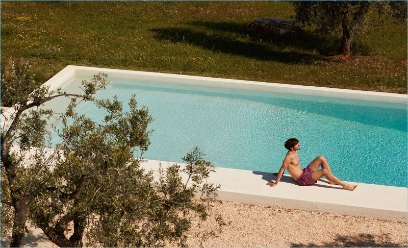Relaxing poolside, Rodolphe Zanforlini sports Le Sirenuse Positano siren flowers print swim shorts $202.