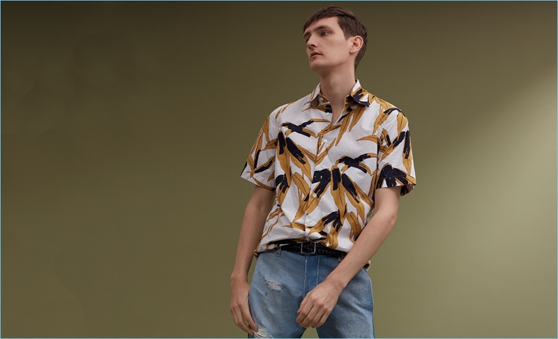 A relaxed vision, Yannick Abrath wears a Marni print shirt, Longjourney T2 denim jeans $612, and a Paul Smith leather belt $150.