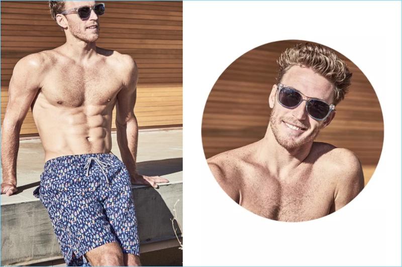 Relaxing poolside, Rodrigo Calazans sports Peter Millar blue print swim trunks $85.
