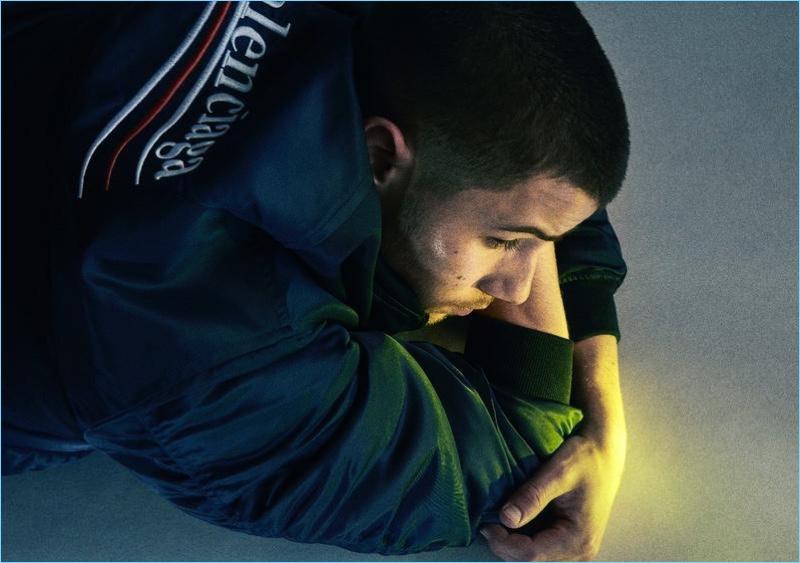 Singer Nick Jonas wears a Balenciaga bomber jacket for HERO magazine.