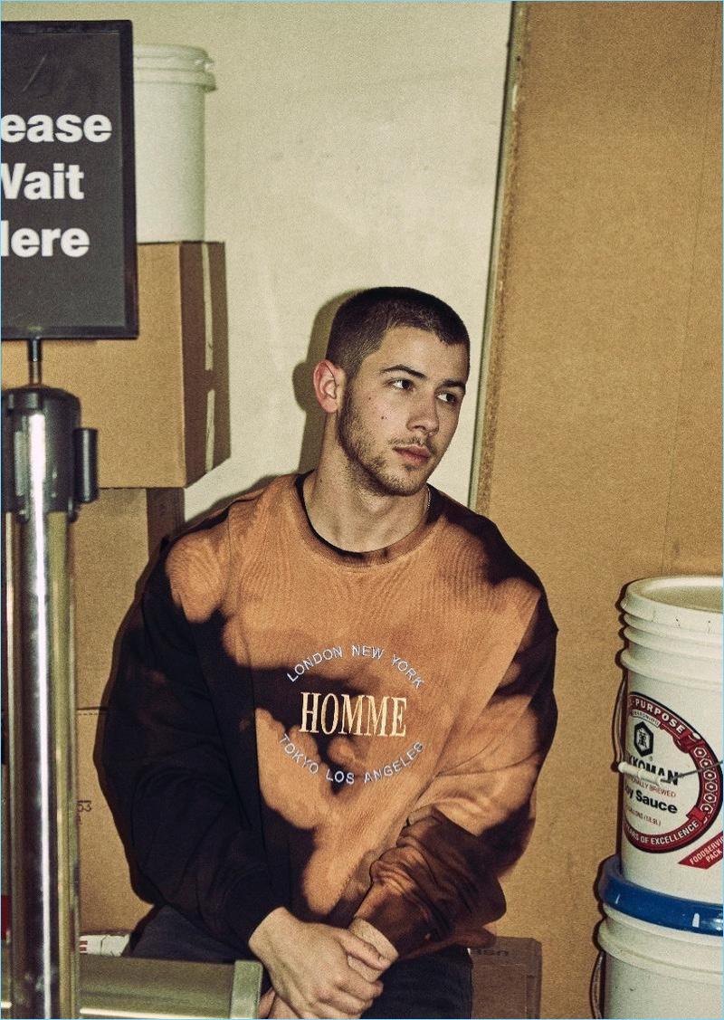 Keeping it casual, Nick Jonas wears a Balenciaga sweatshirt.