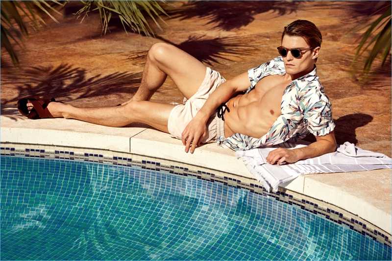 Oliver Cheshire relaxes poolside for NLY Man's summer 2017 campaign.