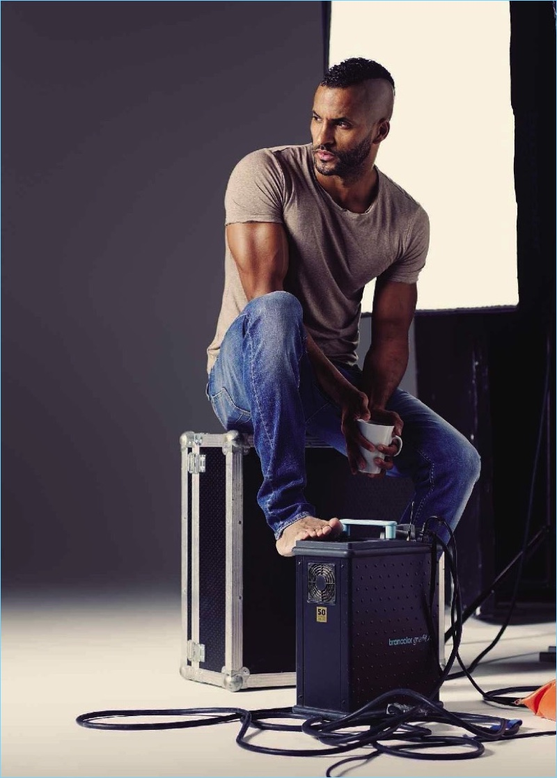 Starring in a photo shoot for Men's Fitness UK, Ricky Whittle wears a H&M t-shirt with Tiger of Sweden denim jeans.