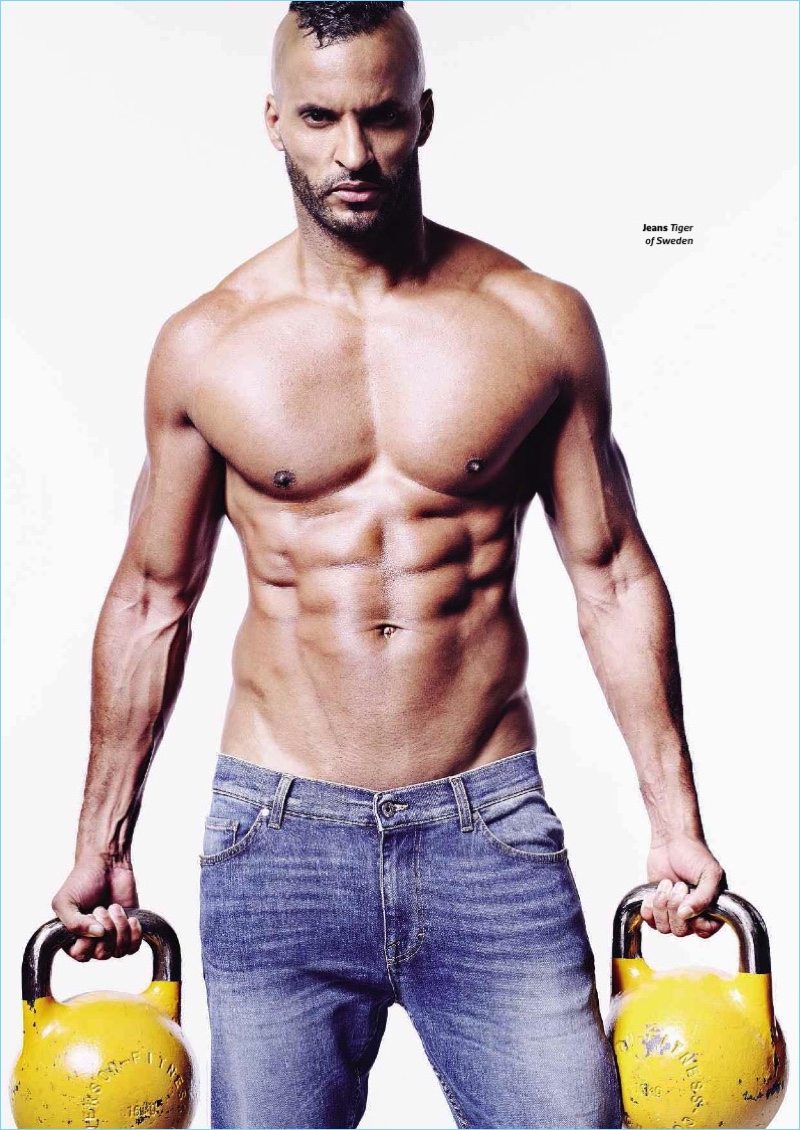 Appearing in a shirtless picture, Ricky Whittle wears Tiger of Sweden jeans.