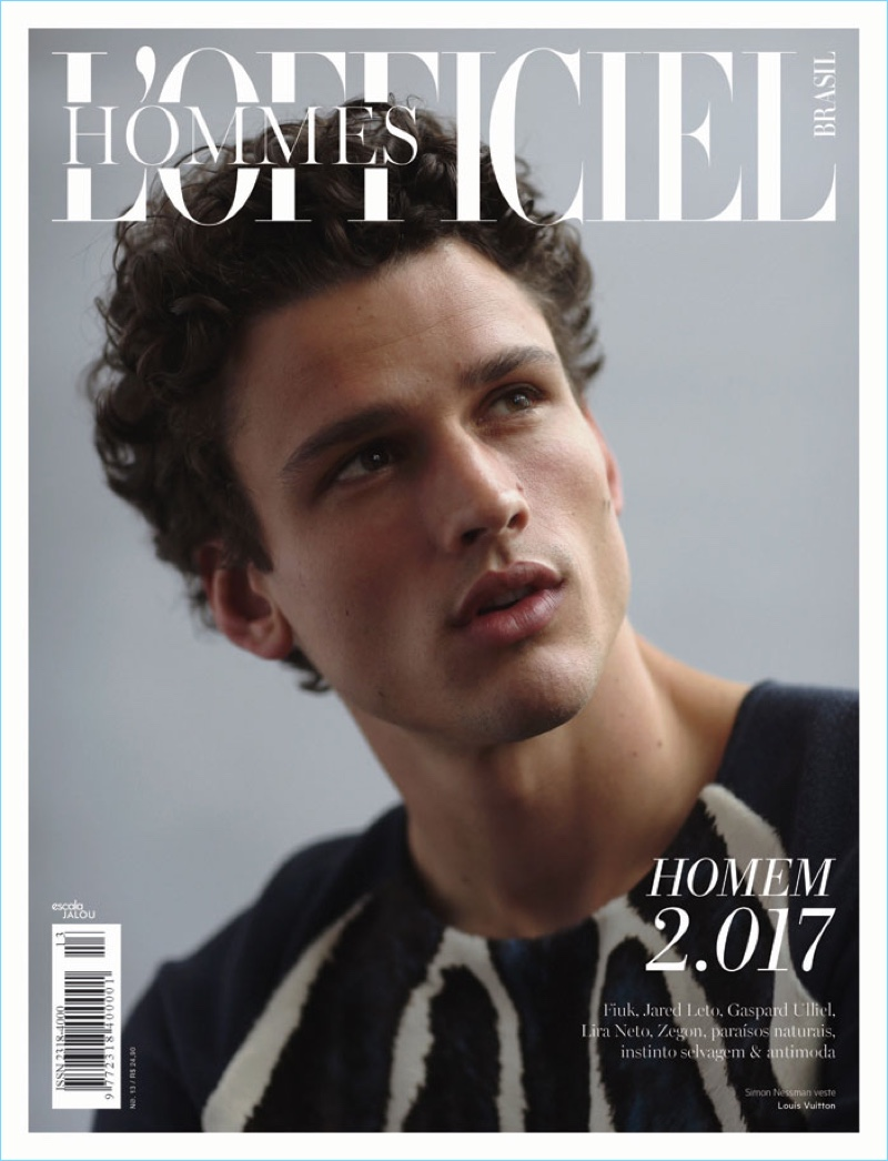 Simon Nessman covers L'Officiel Hommes Brasil in a sweater from French fashion house, Louis Vuitton.