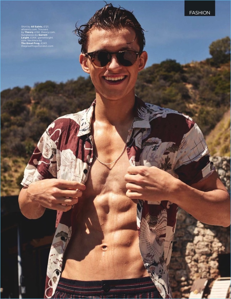 All smiles, Tom Holland wears an AllSaints shirt with Theory trousers and Garrett Leight sunglasses.