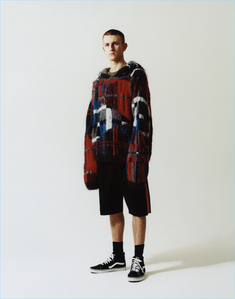 Lewis Murphy sports an oversized pullover and shorts from Topman's fall-winter 2017 collection.