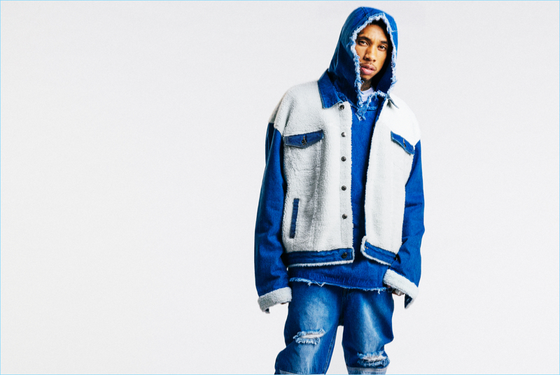 Collaborating with boohooMAN, Tyga wears an oversized distressed denim hoodie $52 and ripped jeans $40.
