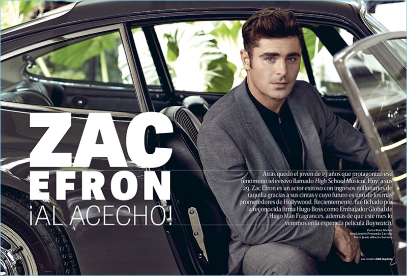 Posing in a car, Zac Efron wears a look by HUGO Hugo Boss.