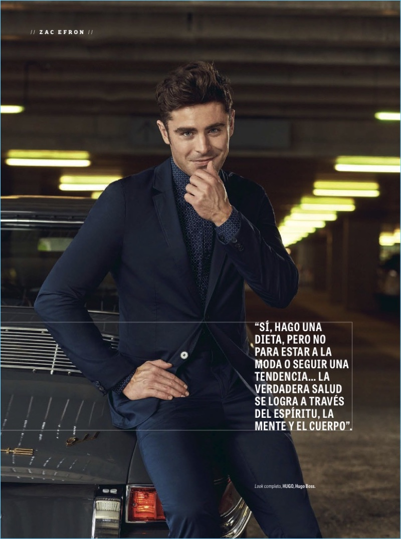 All smiles, Zac Efron dons a suit and printed shirt from HUGO Hugo Boss.