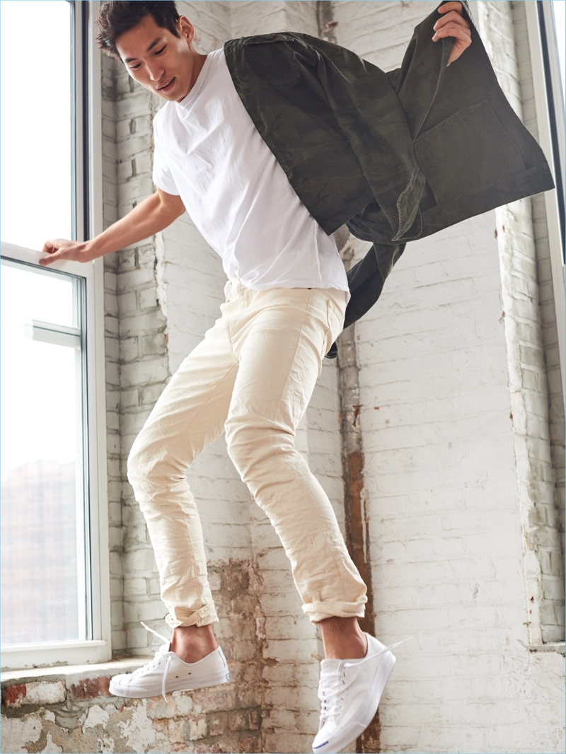 Captured in motion, Jae Yoo wears white Abercrombie & Fitch Felix super slim jeans $30.