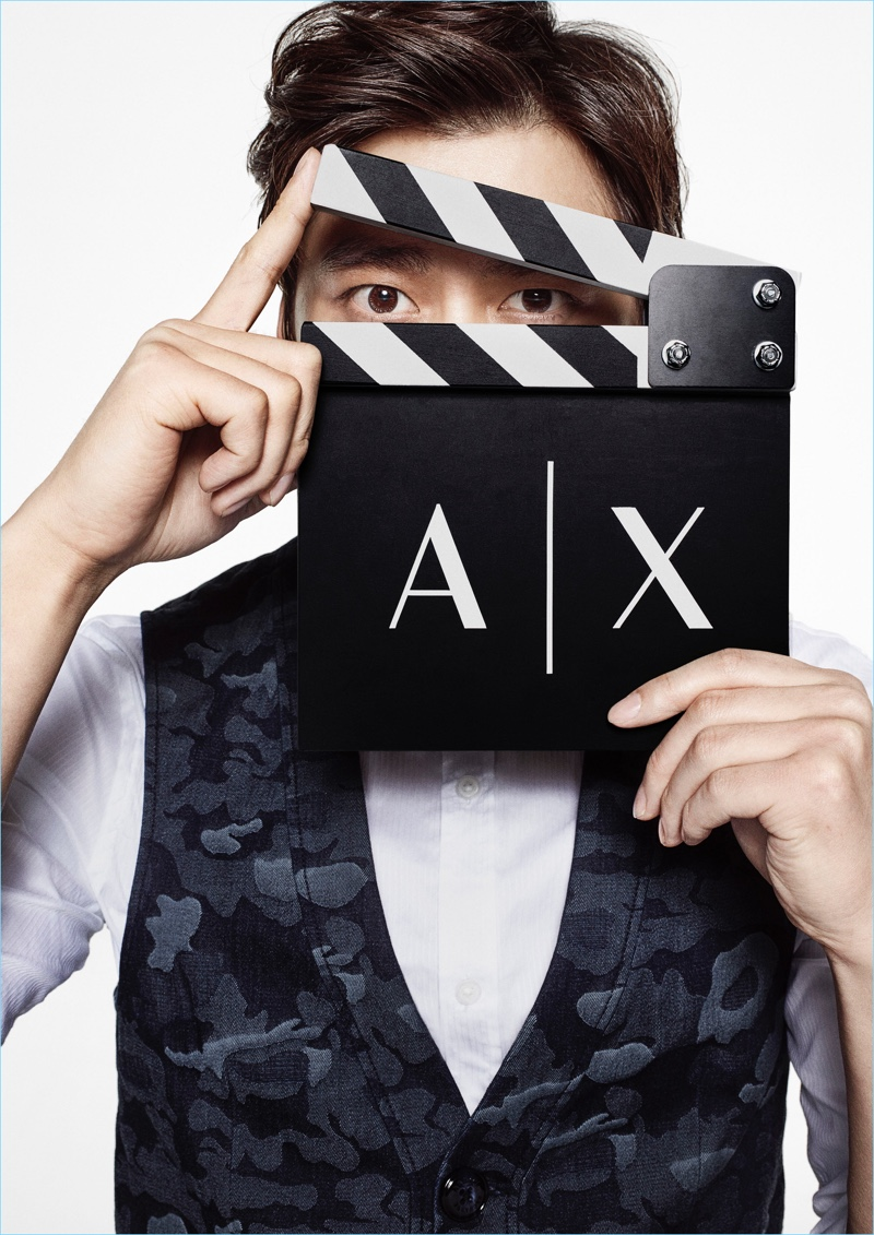 Li Yifeng poses for a cheeky image from Armani Exchange's fall-winter 2017 campaign.