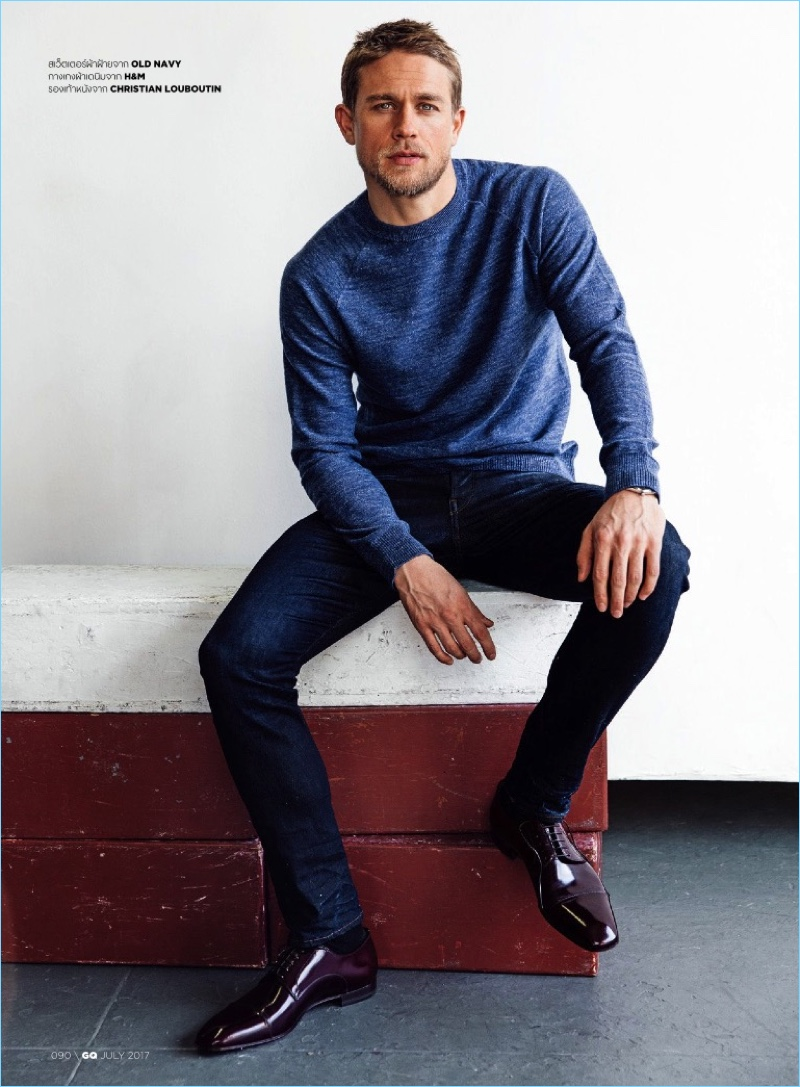 Gracing the pages of GQ Thailand, Charlie Hunnam wears casual staples from Old Navy and H&M.