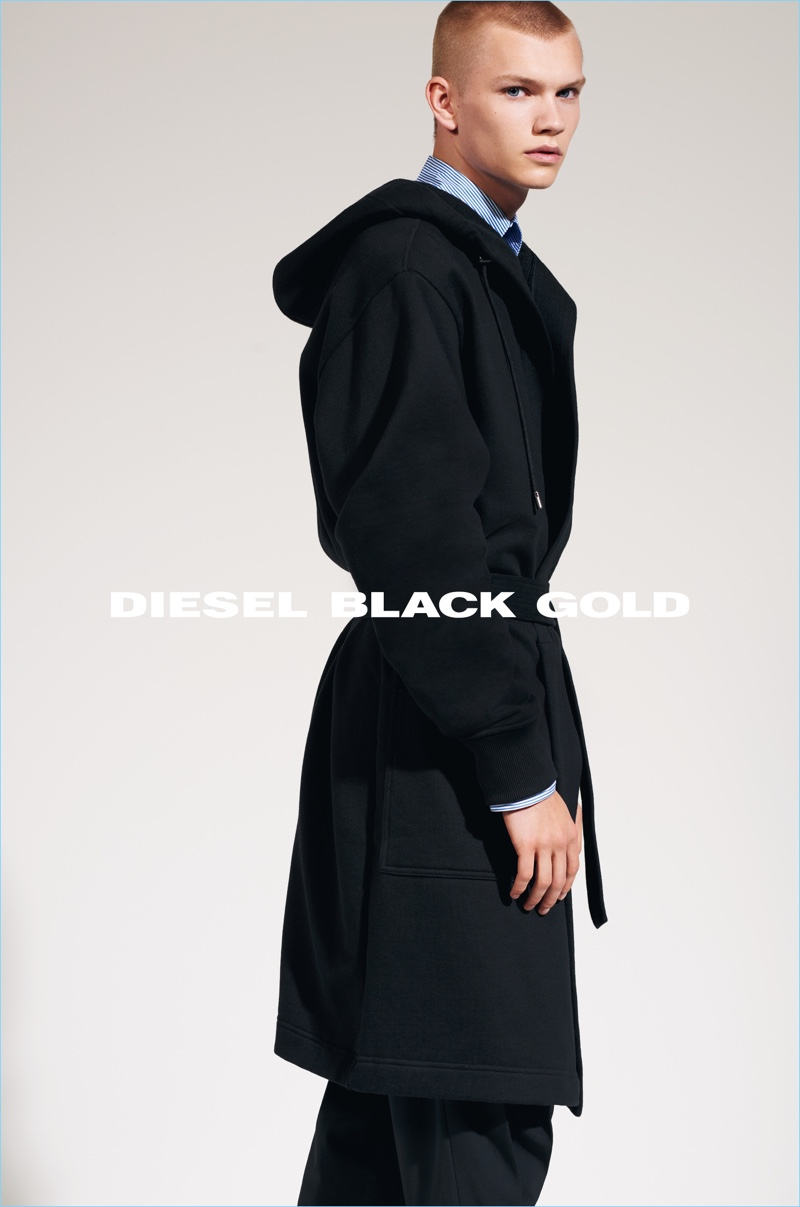 Model Jordy Gerritsma dons a sleek long coat for Diesel Black Gold's fall-winter 2017 campaign.