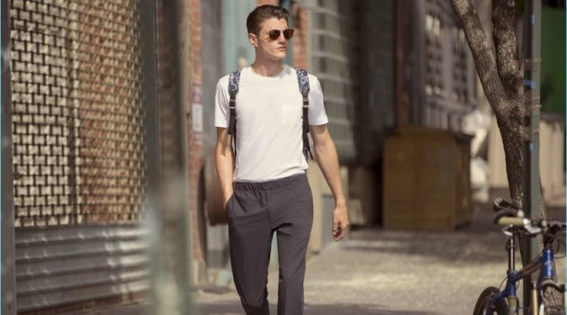 White T-Shirt: Going on a stroll, Eli Hall wears a Sunspel pocket tee $54 with Club Monaco pull on trousers $169 and Rag & Bone sneakers $227.50. Eli's casual look is complete with Ray-Ban sunglasses $160 and a Tumi backpack $345.