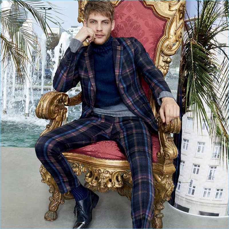 French model Baptiste Radufe dons a plaid suit and navy turtleneck for Etro's fall-winter 2017 campaign.