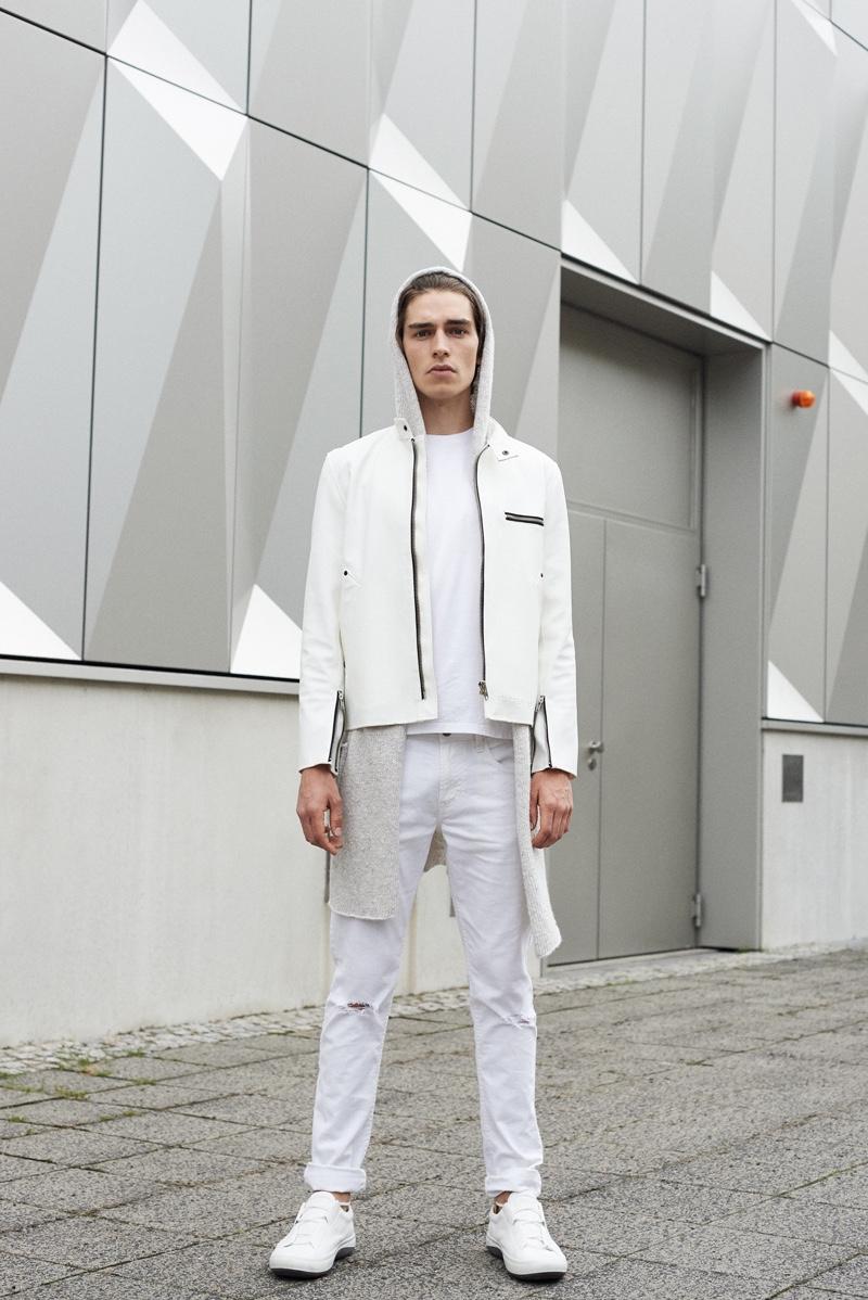 Leon wears jacketStutterheim,t-shirt Asket, cardiganVilla Gaia, pantsTom Tailor,andshoes ECCO.