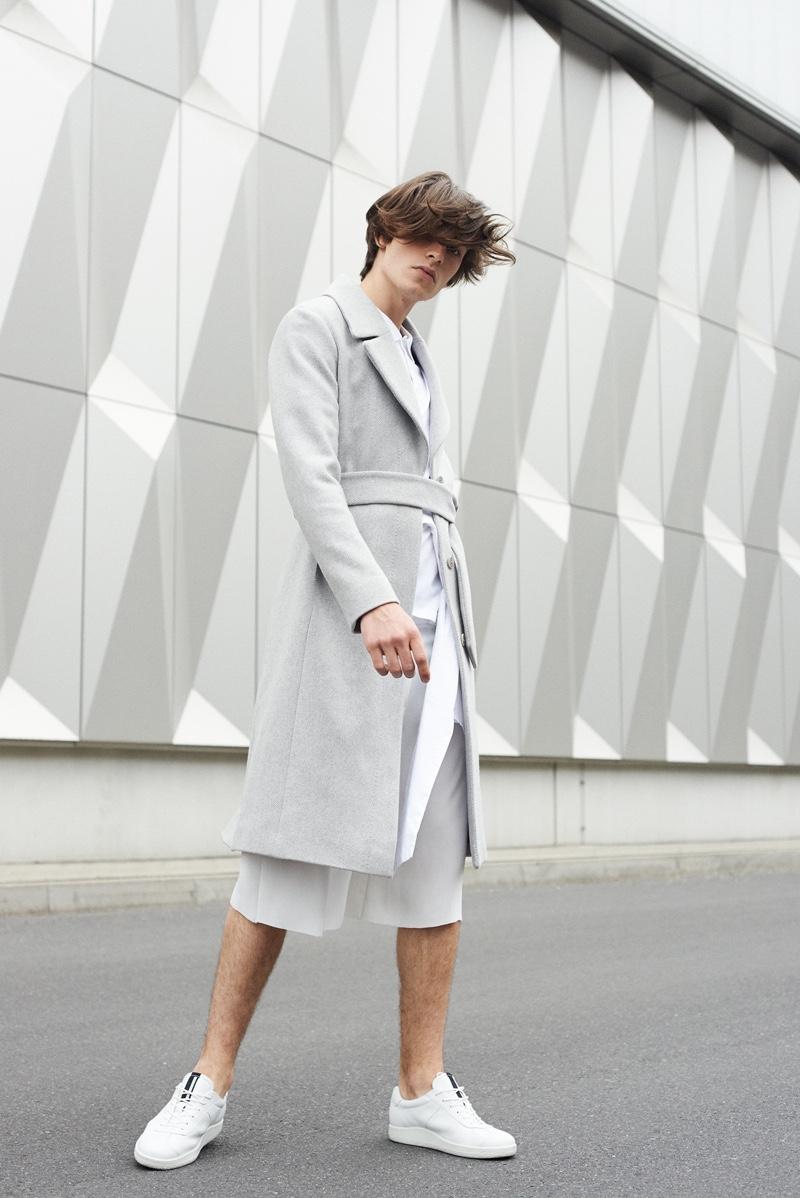 Leon wears coatSt. Emile,shirtVeroModa,pants Vladimir Karaleev, andshoesECCO.