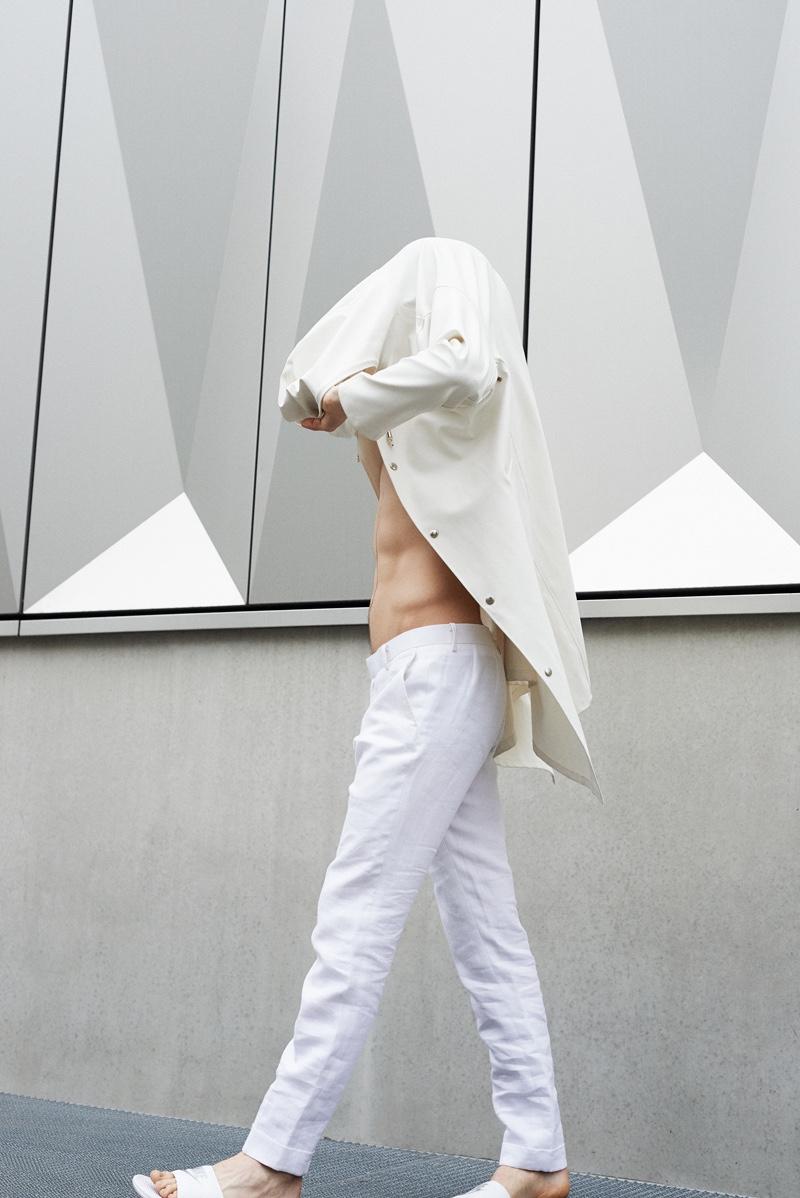 Leon wears coatStutterheimandpants Atelier NA.