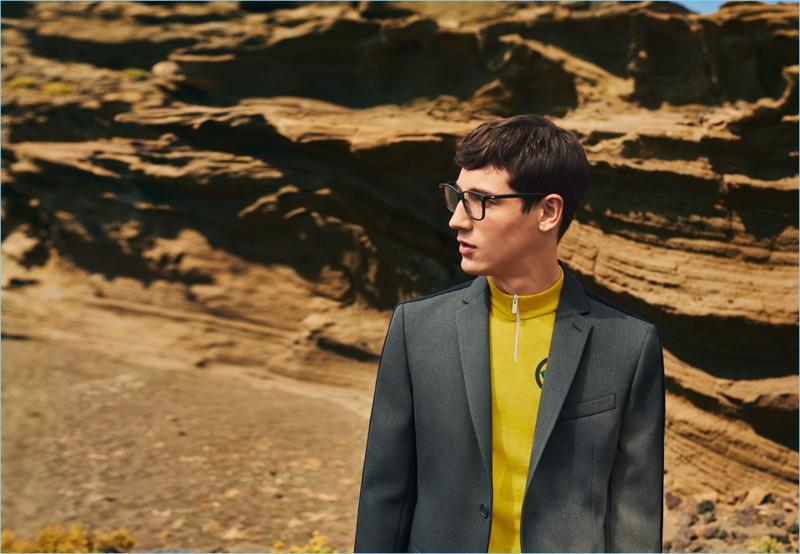 Wearing glasses, Nicolas Ripoll also sports a trim blazer and half-zip top for Fendi's fall-winter 2017 men's campaign.