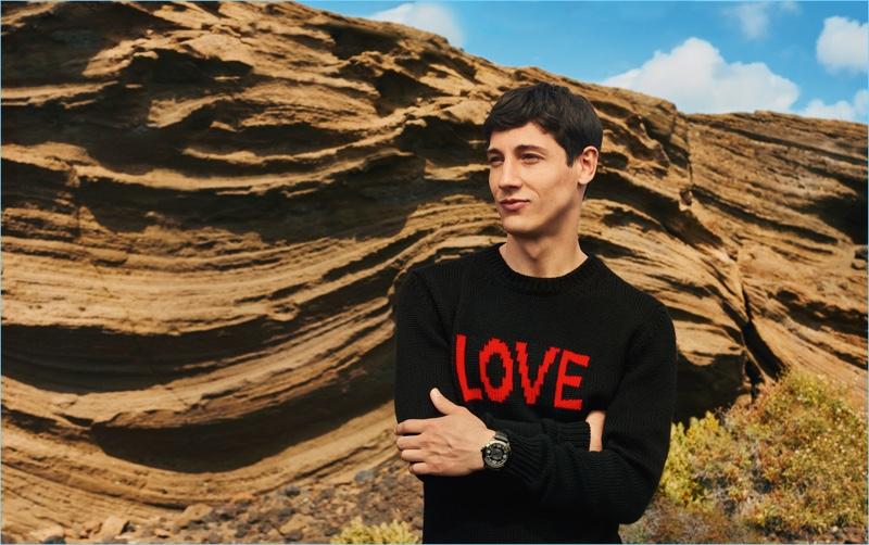 """Nicolas Ripoll sports a """"LOVE"""" sweater for Fendi's fall-winter 2017 men's campaign."""