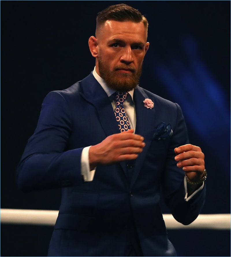 Traveling across the pond, Conor McGregor plays it modest in a navy David August suit.