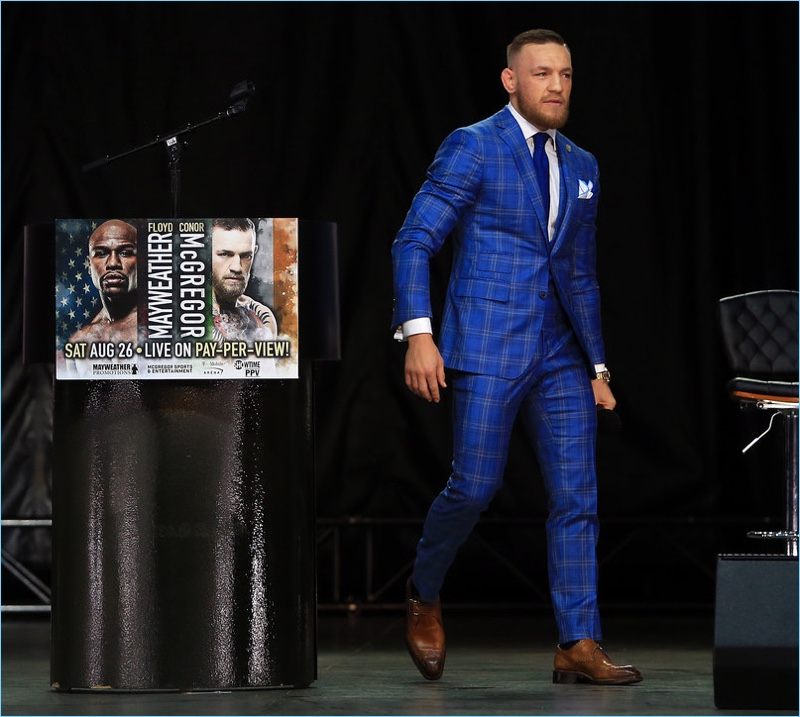 Conor McGregor's visit to Toronto calls for a brilliant blue window plaid suit by David August.