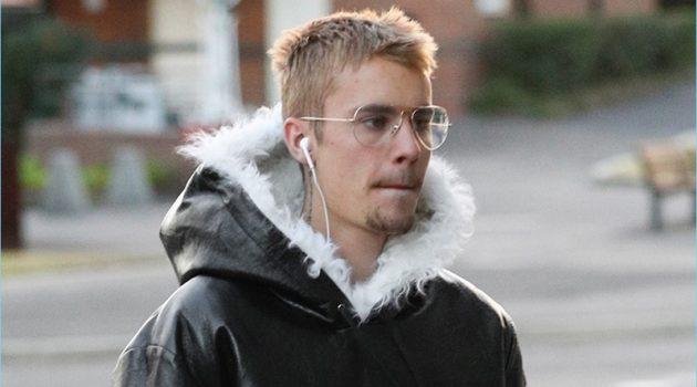 July 2017: Spotted in Sydney, Australia, Justin Bieber wears a Saint Laurent shearling hooded jacket.