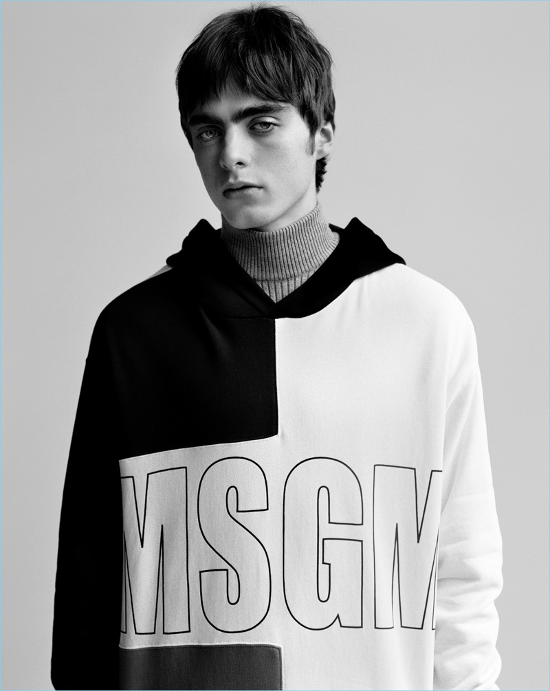 Lennon Gallagher rocks a black and white hoodie for MSGM's fall-winter 2017 campaign.
