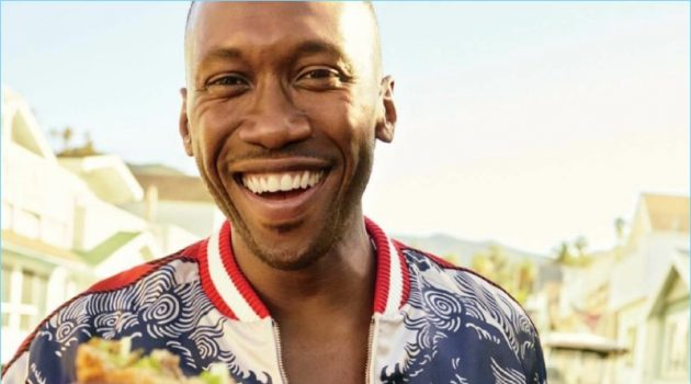 Grabbing a bite to eat, Mahershala Ali wears a tropical print bomber jacket and denim jeans by Gucci.