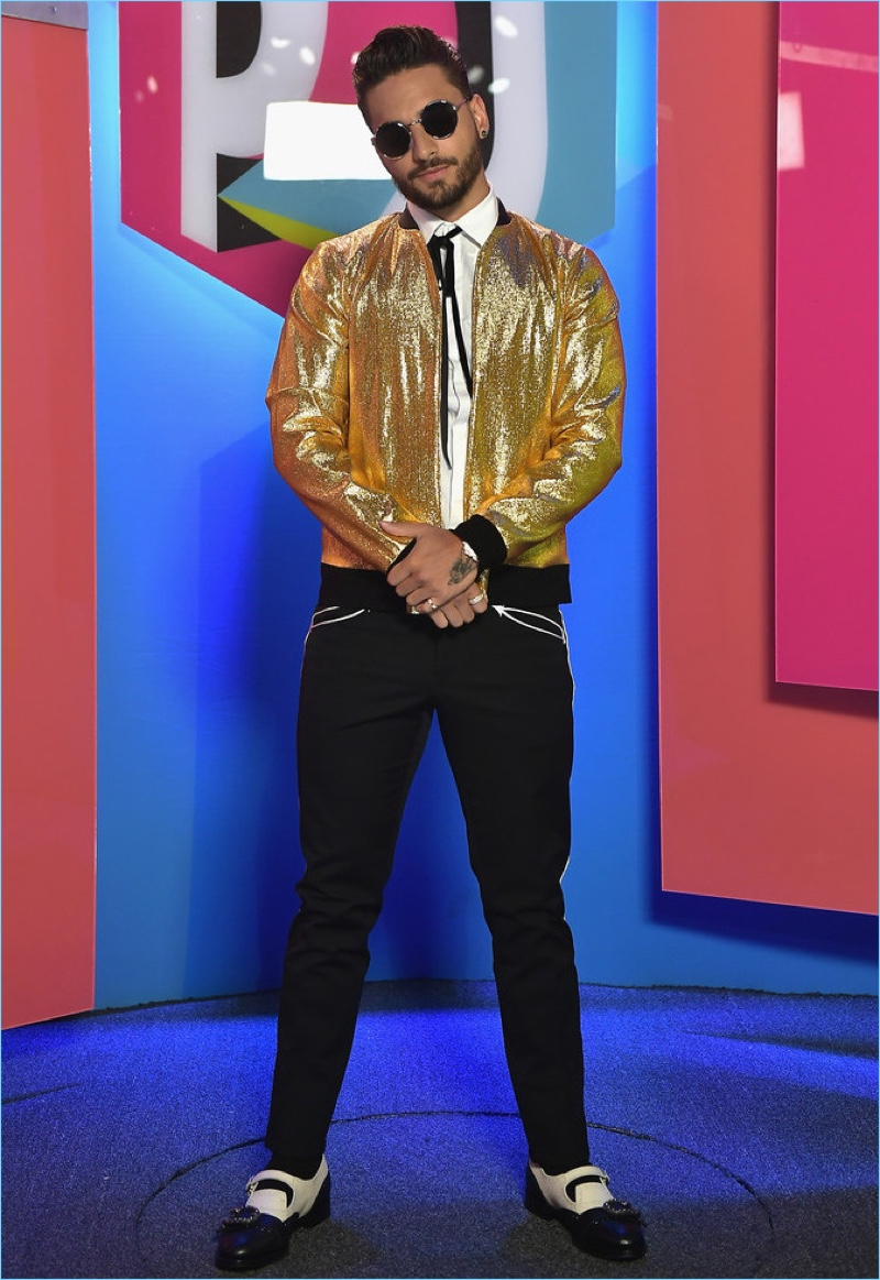 Attending Univision's 2017 Premios Juventud, Maluma makes quite the statement in a gold bomber jacket. He also wears Dolce & Gabbana trousers and Gucci Queercore brogue monk shoes $1,250.
