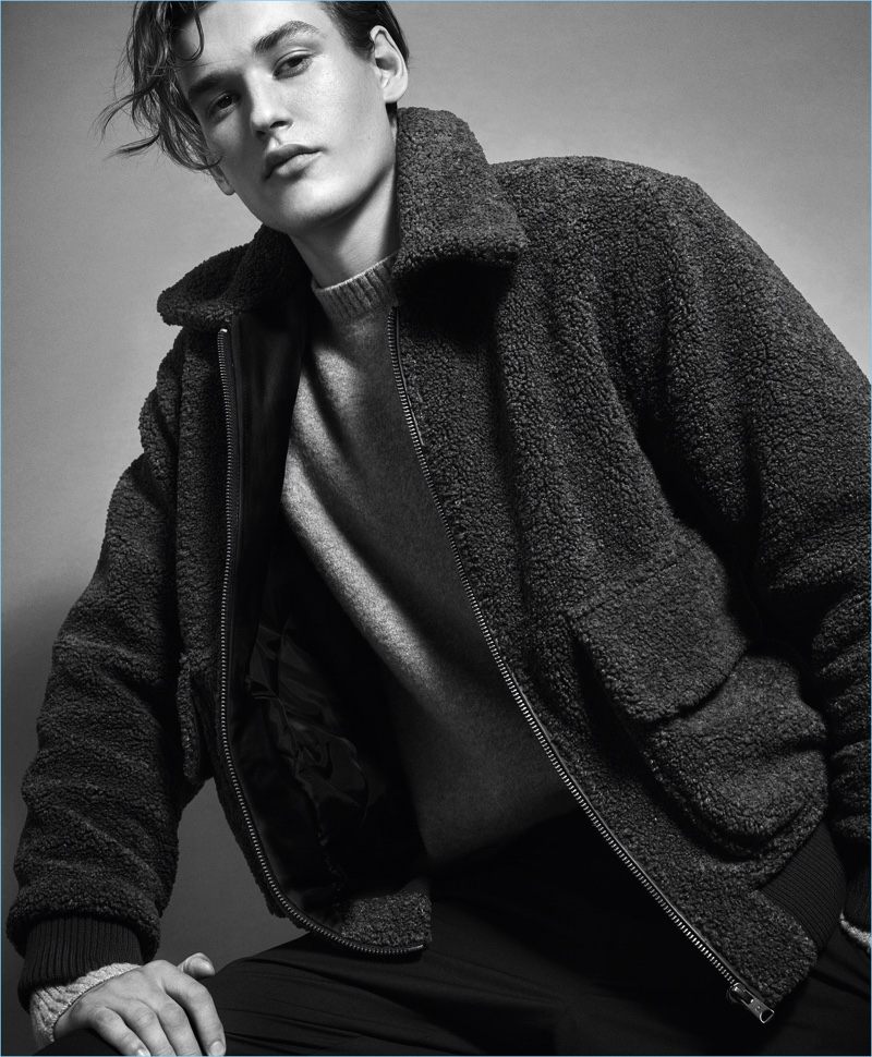 Appearing in a black and white image, Jegor Venned stars in Mango Man's fall-winter 2017 campaign.
