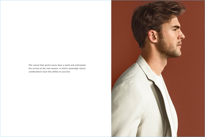 Delivering a side profile, Patrick Kafka dons a neutral sport coat from Massimo Dutti.
