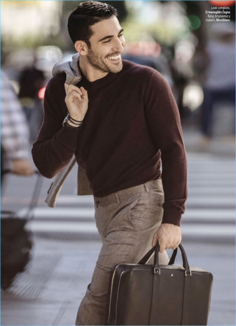 All smiles, Miguel Ángel Silvestre wears an Ermenegildo Zegna look.