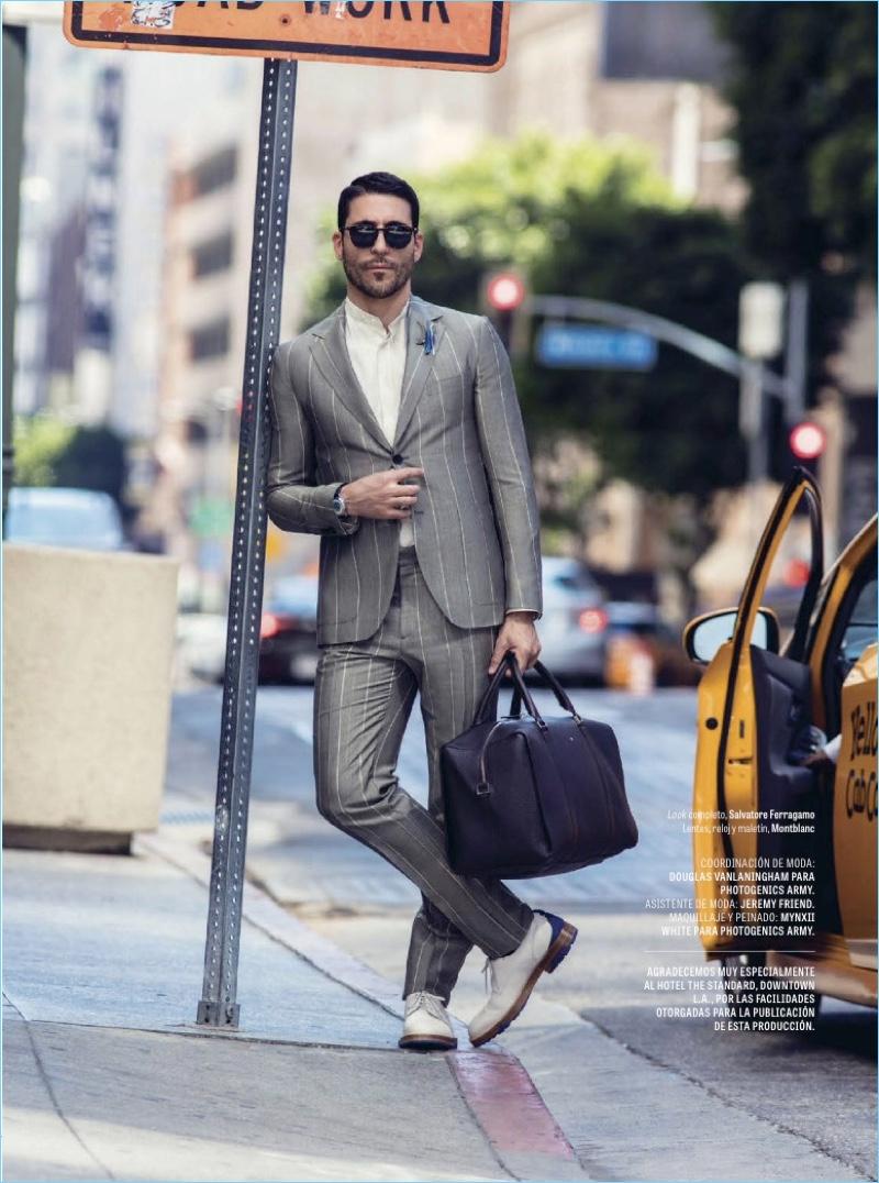 A sharp vision, Miguel Ángel Silvestre dons a Salvatore Ferragamo striped suit.