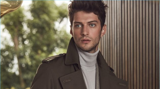 Matthew Bell dons a sleek trench coat from Reiss' fall-winter 2017 collection.