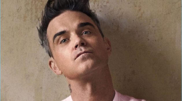 Robbie Williams wears a pink logo sweater from his Marc O'Polo collaboration.