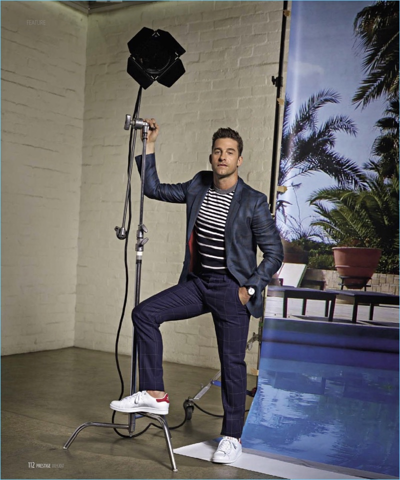 Actor Scott Speedman dons a jacket, shirt, and trousers by Paul Smith with Adidas sneakers.