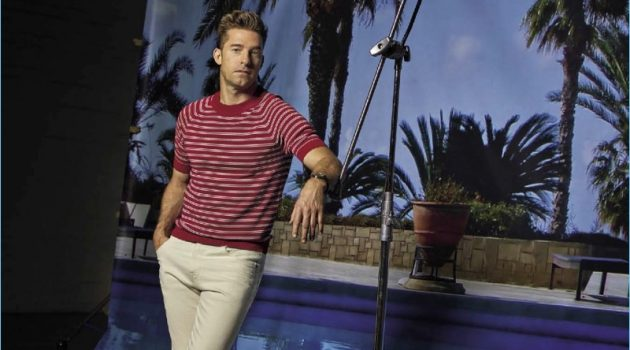 Scott Speedman wears a striped red sweater by Sandro with Ralph Lauren jeans and Adidas sneakers.
