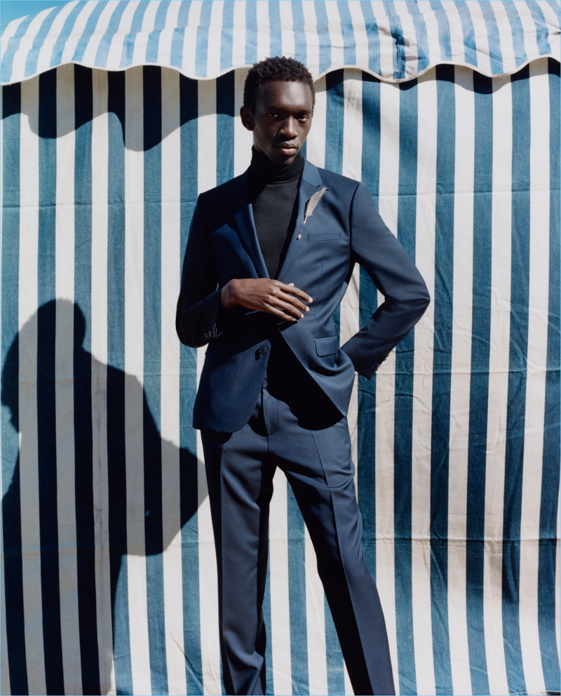 Wilson Oryema dons a sharp suit for HUGO's fall-winter 2017 campaign.