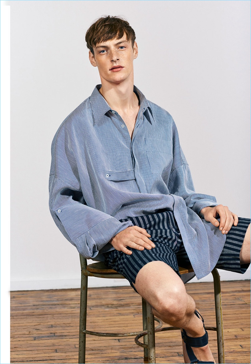 Embracing the oversize trend, Roberto Sipos wears a shirt with striped Bermuda shorts from Zara Man's Studio collection.