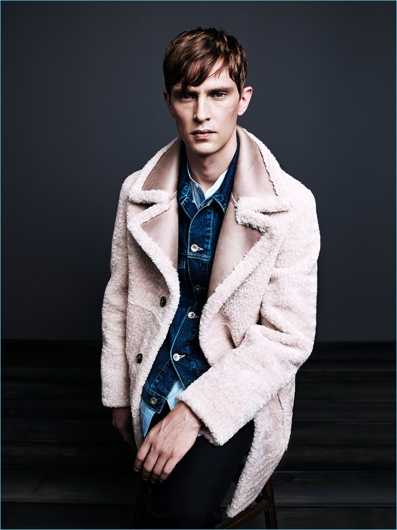 Mathias Lauridsen models a shearling style coat for Zara Man's fall-winter 2017 campaign.