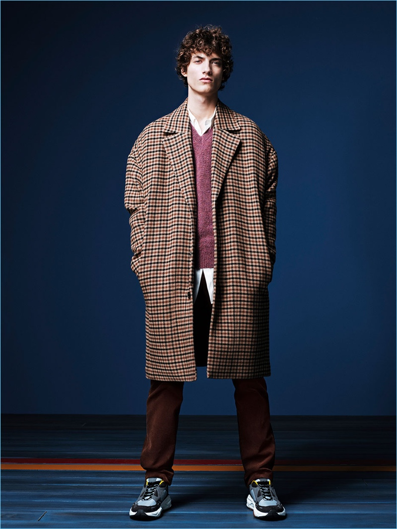 Serge Rigvava rocks a plaid oversize coat for Zara Man's fall-winter 2017 campaign.
