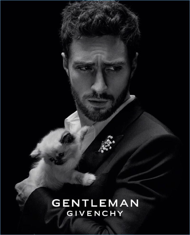 English actor Aaron Taylor-Johnson poses with a cat for the fragrance campaign of Gentleman Givenchy.