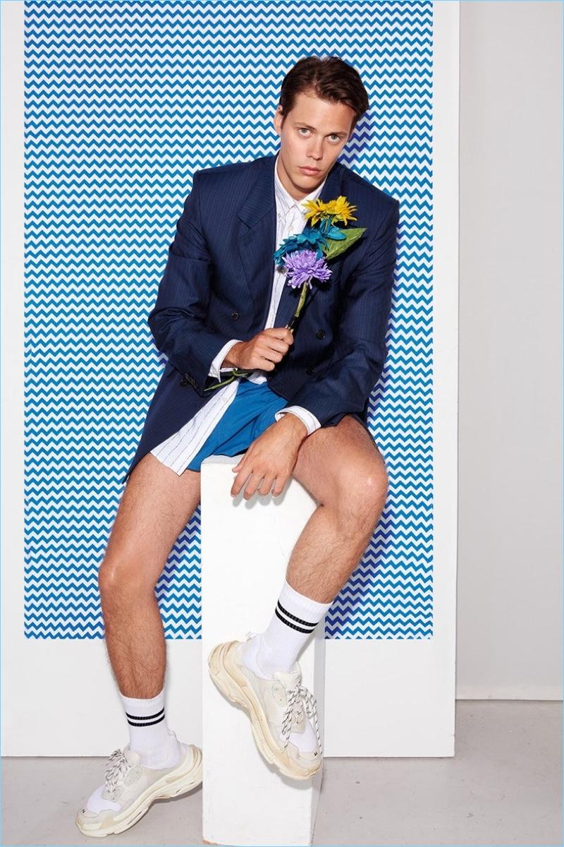 Actor Bill Skarsgård dons a Balenciaga look with vintage shorts for Dazed.